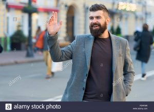 hipster-in-casual-coat-happy-to-meet-friend-at-urban-street-chance-meeting-concept-meet-old-friend-by-accident-man-bearded-businessman-waiting-someone-in-city-center-happy-to-meet-you-R24KM6 (1)